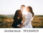 romantic newlywed bride and... | Shutterstock . vector #591334019