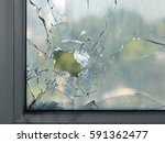 hole in the window glass by a... | Shutterstock . vector #591362477