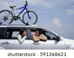 couple sitting in car  leaning... | Shutterstock . vector #591368621