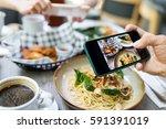 friends taking photo on... | Shutterstock . vector #591391019