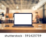 laptop with blank screen on... | Shutterstock . vector #591425759