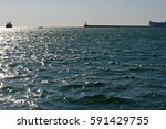 calm sea with a lighthouse and...   Shutterstock . vector #591429755