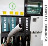hand holding a petrol pump in a ... | Shutterstock . vector #591435995