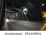 asphalt road under the steel... | Shutterstock . vector #591439841