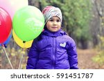 child with balloons in the park.... | Shutterstock . vector #591451787