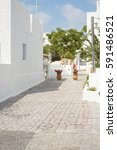 Small photo of patio with flowers in Kamari town on the island of Thera Santorini, Greece.