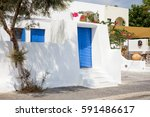 blue door of traditional greek... | Shutterstock . vector #591486617