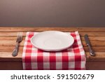 empty plate with tablecloth and ... | Shutterstock . vector #591502679