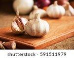 garlic. garlic cloves and... | Shutterstock . vector #591511979