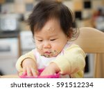 baby eating messy mashed potato | Shutterstock . vector #591512234