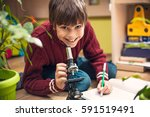 portrait of little boy using... | Shutterstock . vector #591519491