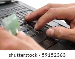 Person with a credit card using a computer for internet shopping - stock photo