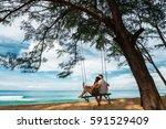couple in love on a swing by... | Shutterstock . vector #591529409