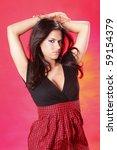 striking brunette on red setting | Shutterstock . vector #59154379
