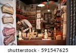 Small photo of ROME, ITALY - August 23, 2013: Traditional craftsman carving wood in Pinocchio shape in a shop in Rome