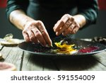 close up of male hands cooking... | Shutterstock . vector #591554009