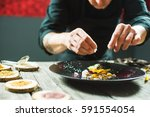 close up of male hands cooking... | Shutterstock . vector #591554054