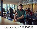 the barman prepares fresh juice ... | Shutterstock . vector #591554891
