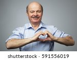 old man making out of hands... | Shutterstock . vector #591556019