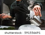 male bold chef dressed in black ... | Shutterstock . vector #591556691