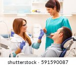 female dentists examining and... | Shutterstock . vector #591590087