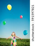 happy child playing with bright ...   Shutterstock . vector #591597821