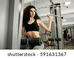 woman training in gym | Shutterstock . vector #591631367