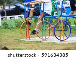 A Boy Playing Colorful Bike In...