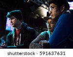 """Small photo of SACRAMENTO - FEBRUARY 18: eSports athletes Kevin """"Panoptic"""" Yates and Aung Kyaw spectating at Extra Life fighting game tournament to benefit Children's Miracle Network Hospitals on Feb 18, 2017."""