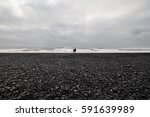Black Sand Beach Of Volcanic...