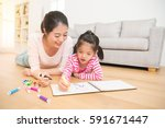 happy mixed race asian mother...   Shutterstock . vector #591671447