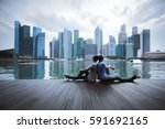 couple sitting relax in the... | Shutterstock . vector #591692165