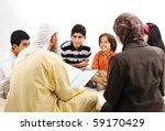 Education activity in Ramadan, Muslim arabic couple and children reading Koran - stock photo