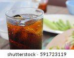 cola glass with soft focus | Shutterstock . vector #591723119