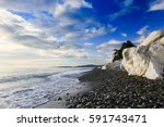 sea coast at sunset time. | Shutterstock . vector #591743471