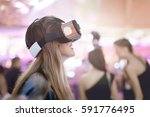 female wearing virtual reality... | Shutterstock . vector #591776495