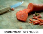 carrot cut in heart shape  | Shutterstock . vector #591783011