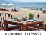 A Table In A Cafe On The Beach