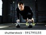 powerful adult man wearing... | Shutterstock . vector #591795155