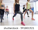 cross fitters doing lunges with ... | Shutterstock . vector #591801521