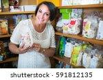 smiling mature female customer... | Shutterstock . vector #591812135