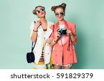 fashion portrait of hipster... | Shutterstock . vector #591829379