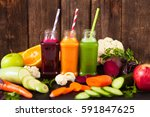 freshly squeezed vegetable... | Shutterstock . vector #591847625
