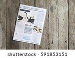 newspaper on wooden table | Shutterstock . vector #591853151