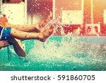 boys legs splashing water in... | Shutterstock . vector #591860705