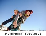 young man holding in his arms... | Shutterstock . vector #591868631