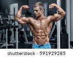 sexy muscular man in gym... | Shutterstock . vector #591929285