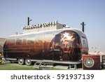 Small photo of DUBAI, UAE - NOV 27, 2016: Airstream caravan converted to the Starbucks Coffee shop at the Last Exit food trucks park on the E11 highway in United Arab Emirates