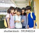 group of asian pupils looking... | Shutterstock . vector #591940214
