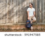 a young casual men with beard ... | Shutterstock . vector #591947585